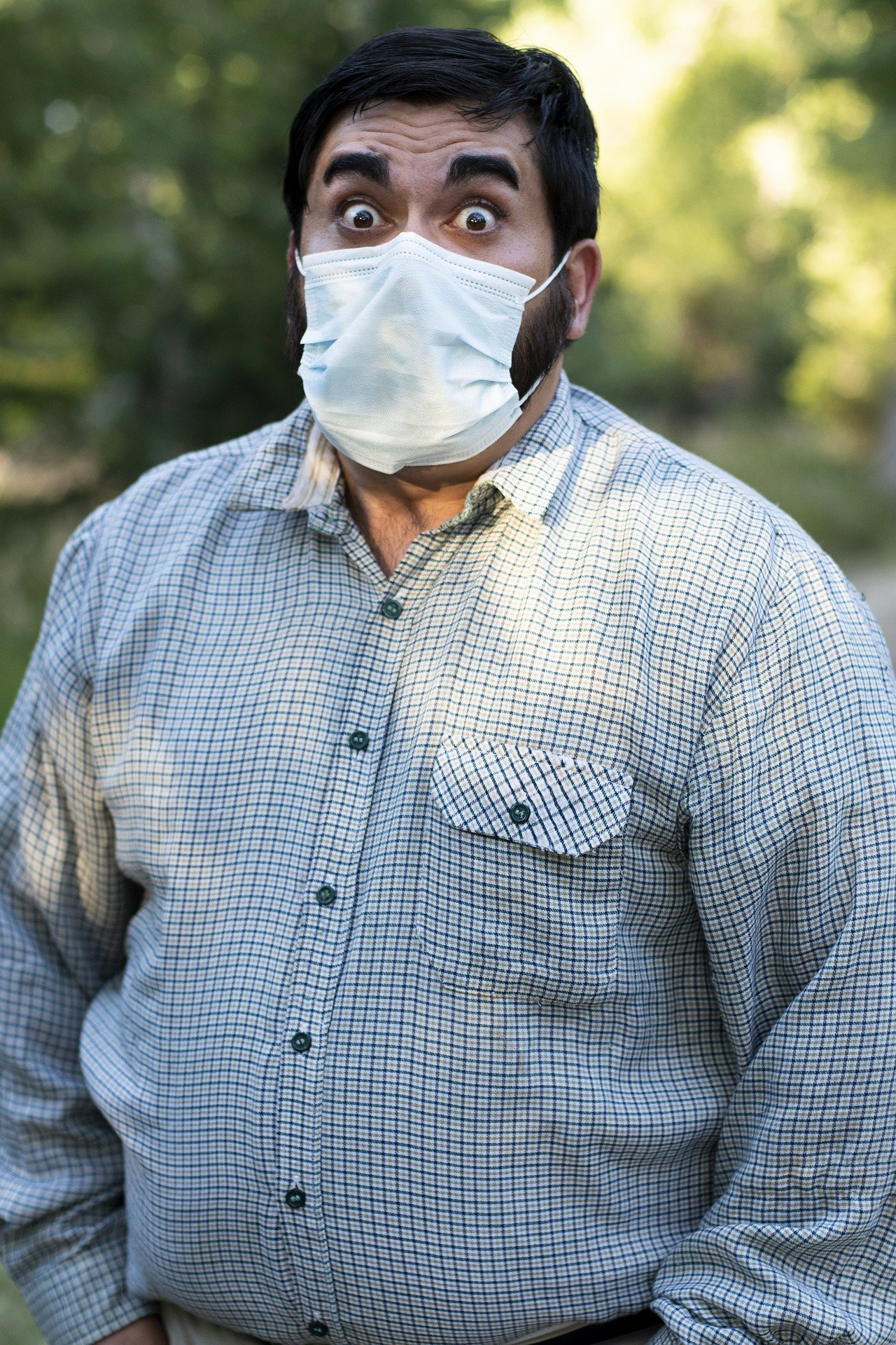 A frightened man standing in an open area with a face mask on   Photo: Pixabay/Sean Corcoran