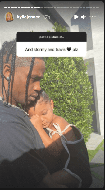 A picture of Travis Scott carrying his babygirl Stormi on his chest while she is sleeping. | Photo: Instagram/Kyliejenner