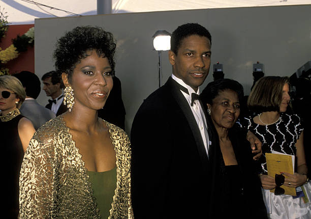 Pauletta Washington, Denzel Washington and mother at the 62nd Annual Academy Awards,  March 26, 1990 | Photo: GettyImages