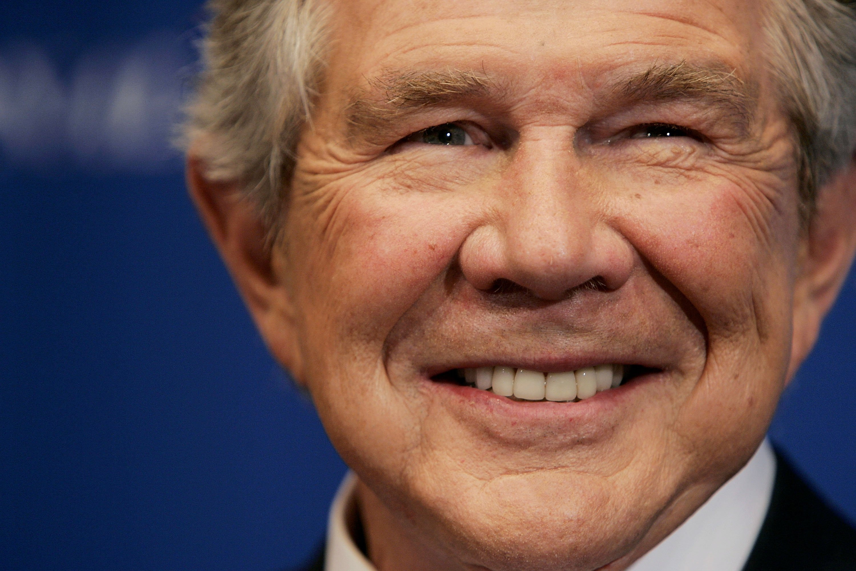 Pat Robertson, founder of CBN, smiles as he is introduced before speaking at the National Press Club on February 15, 2005 in Washington, DC. | Photo: Getty Images