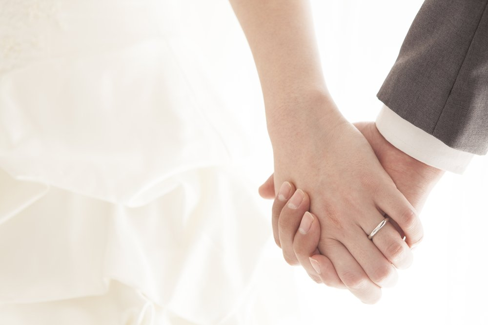 Married couple holding hands   Source: Shutterstock