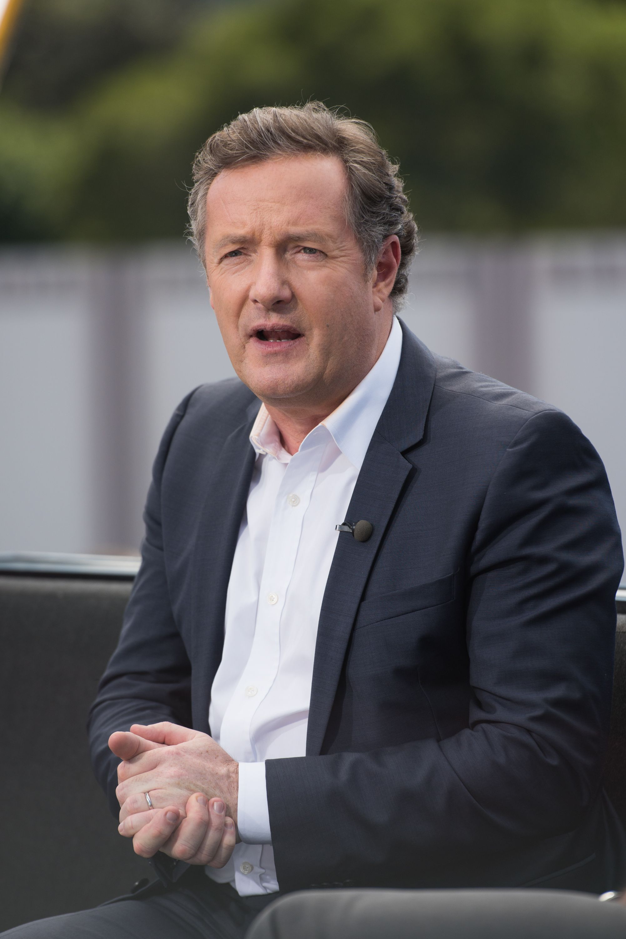 """Piers Morgan visits """"Extra"""" at Universal Studios Hollywood on February 11, 2016. 