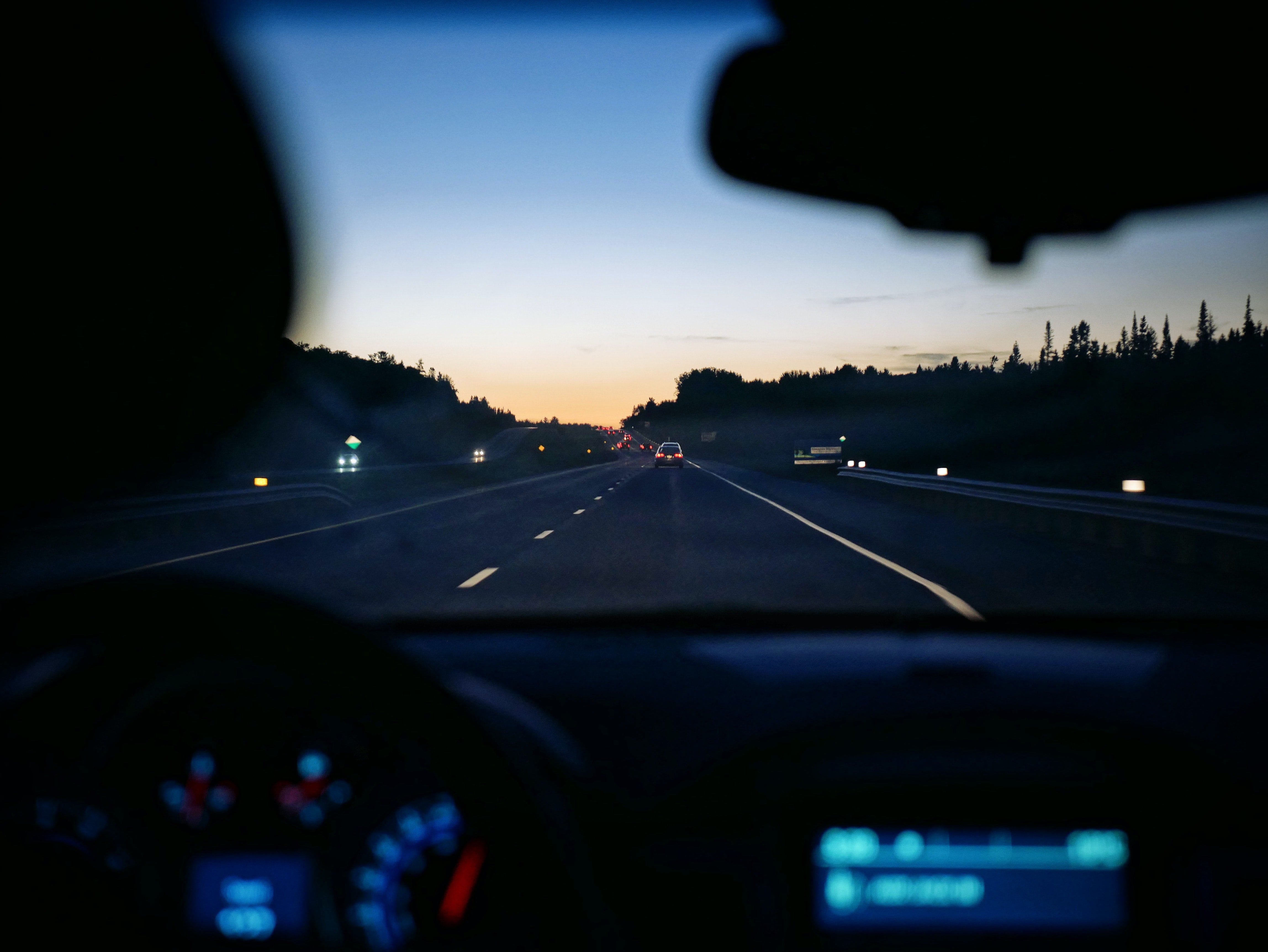 Car driving on a highway | Source: Unsplash