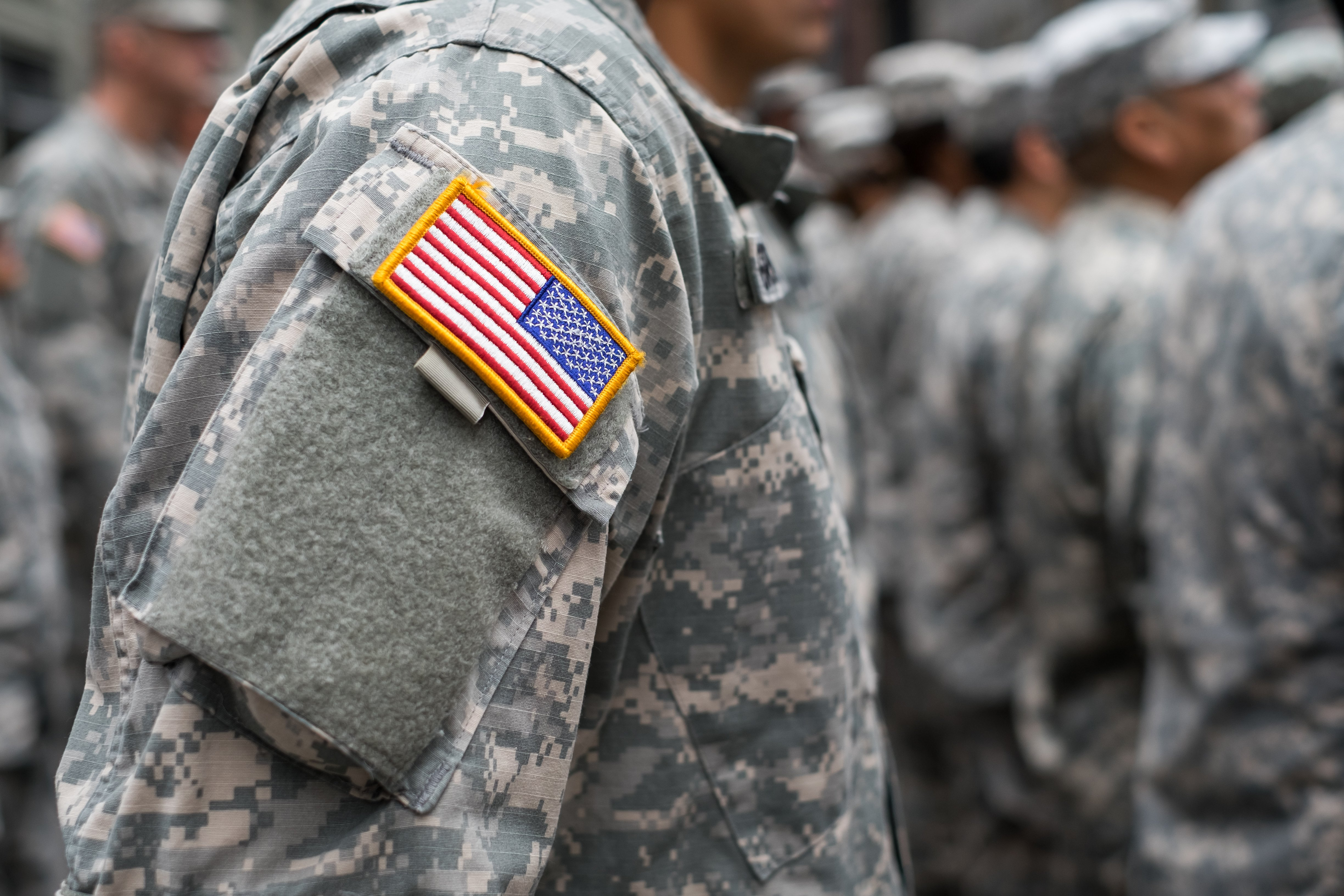 USA patch flag on soldiers arm   Photo: Shutterstock