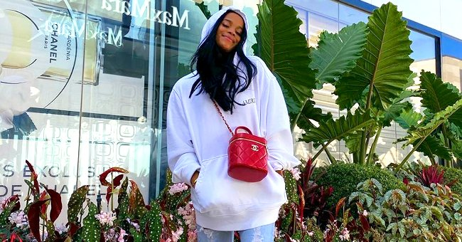 LL Cool J's Daughter Samaria Looks like Her Mom Posing in a White Sweater & Distressed Jeans