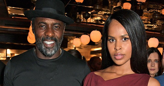 Idris Elba's 3rd Wife Sabrina Turns Heads Pouring Her Curves into a $2000 Black Leopard Gown with Gloves
