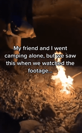 Photo of a guy breaking firewood by wedging it on his leg to feed the campfire | Photo: TikTok / carterbooth