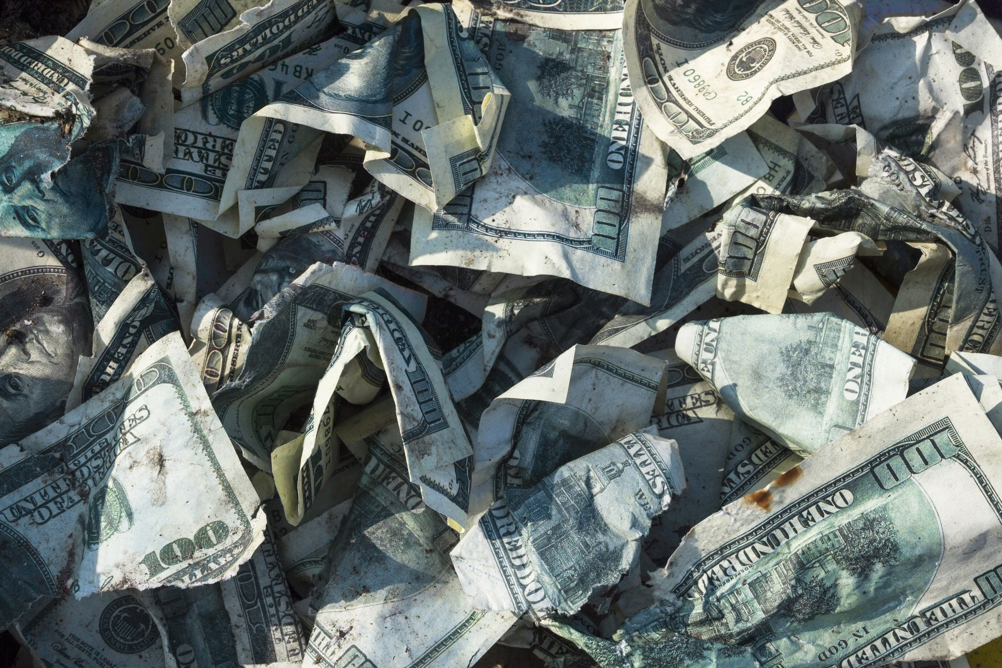 A bunch of dirty and scrunched up $1.00 bills. | Source: Shutterstock