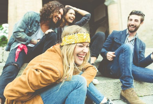 A group of friend laughing out loud. | Source: Shutterstock