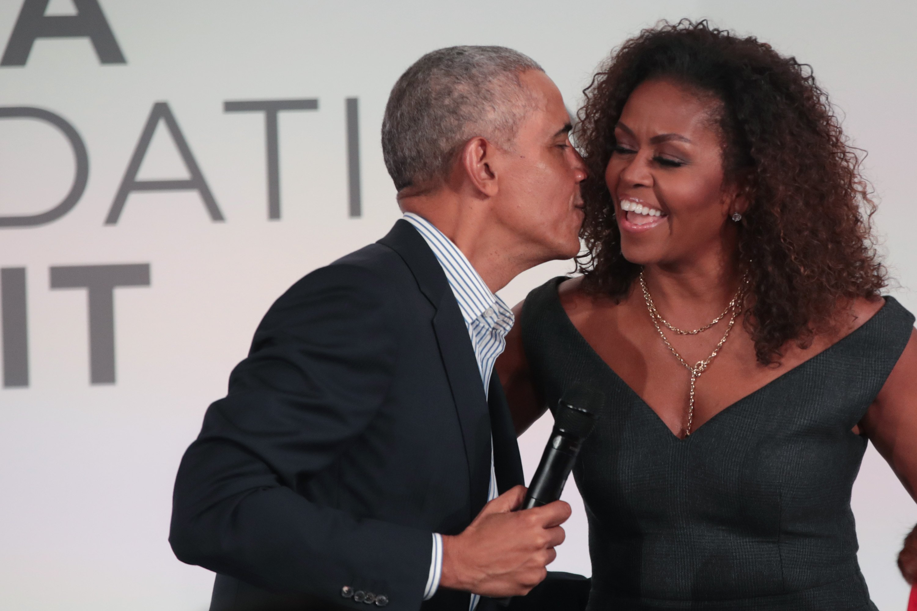 Barack Obama gives his wife Michelle a kiss as they close the Obama Foundation Summit together on the campus of the Illinois Institute of Technology on October 29, 2019. | Source: Getty Images