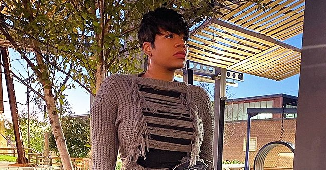 Fantasia Barrino Stuns Displaying Seductive Curves in a Long Ripped Sweater & Thigh-High Boots