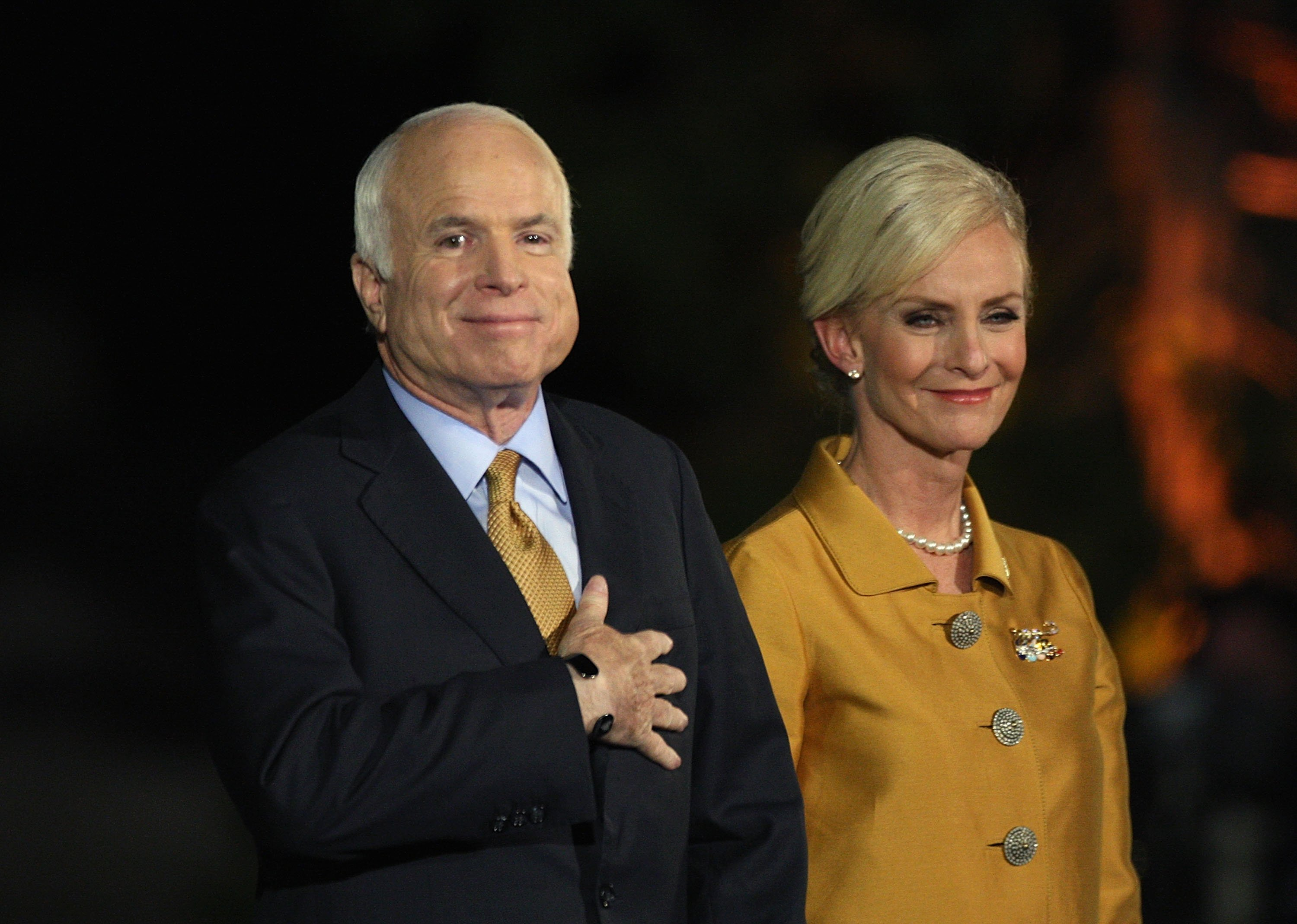 Late U.S. Sen. John McCain concedes victory on stage with his wife Cindy McCain during the election night rally in 2008. | Source: Getty Images