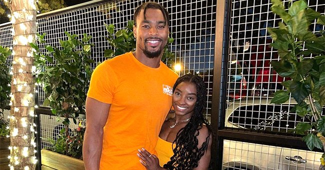 Olympic gold medalist and NFL player Jonathan Owens smiling at the camera in celebration of their first year together   Photo: Instagram.com/simonebiles