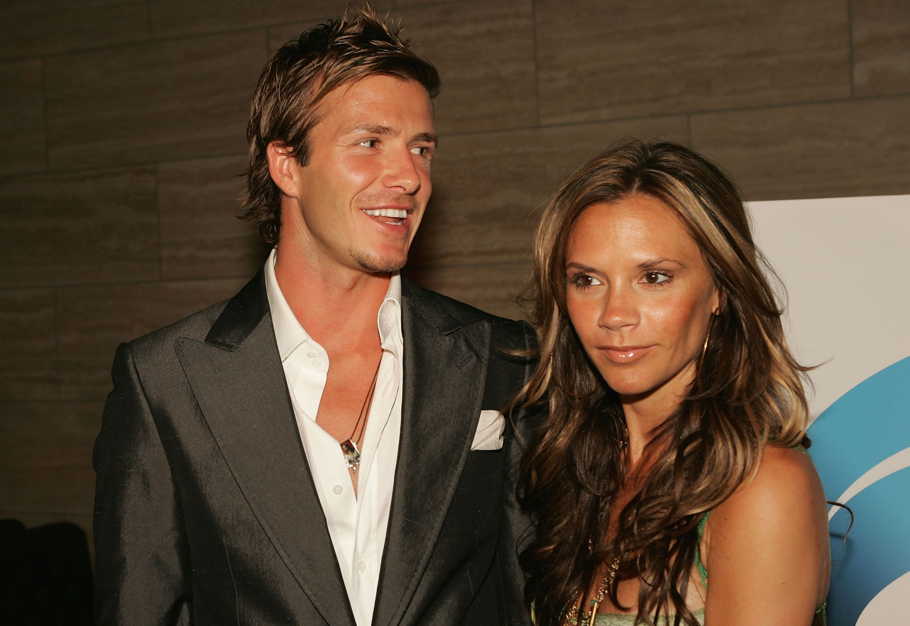 "David Beckham and wife Victoria pose at ""The David Beckham Academy"" launch party at Creative Artists Agency on June 3, 2005 in Beverly Hills, California. 