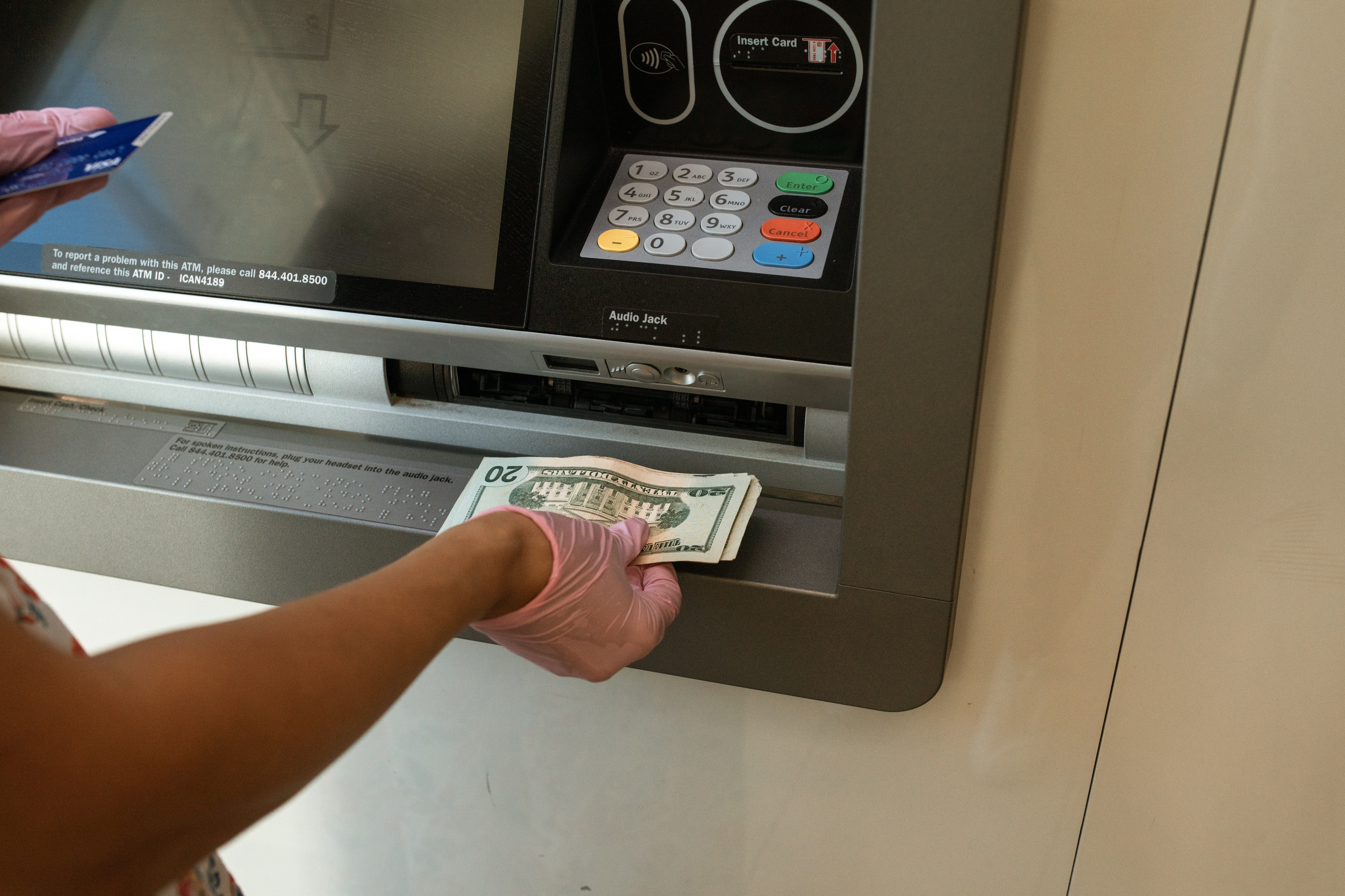 A customer withdrawing monet from an ATM   Source: Pexels