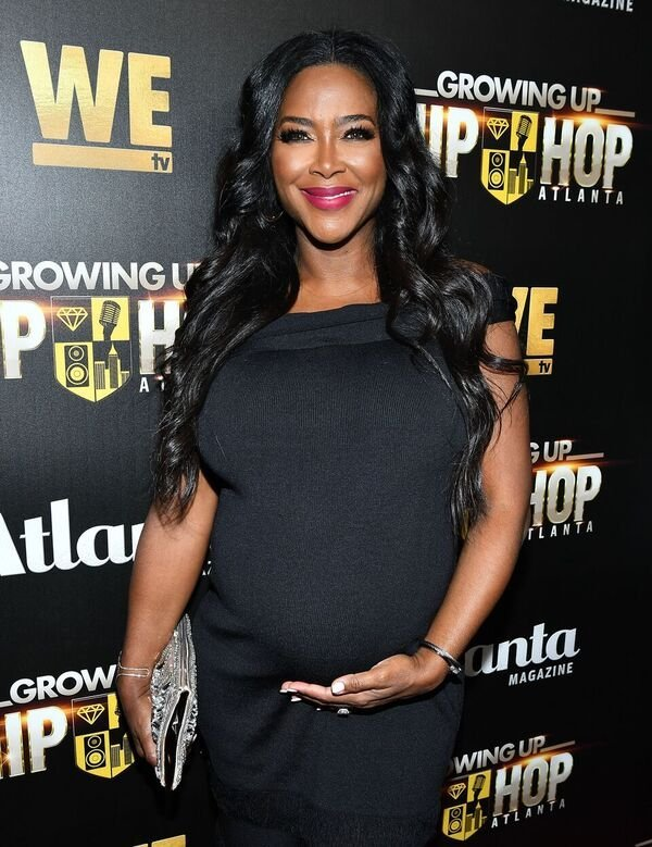 """A pregnant Kenya Moore at the red carpet of a """"Growing Up Hip Hop"""" event 