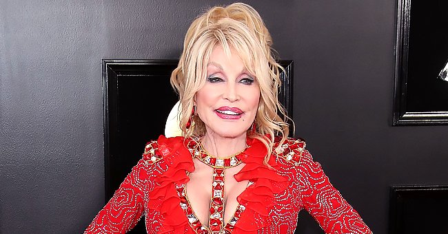 Dolly Parton Hangs Out with Her God-dog in a Yellow Blouse & Black Skintight Pants