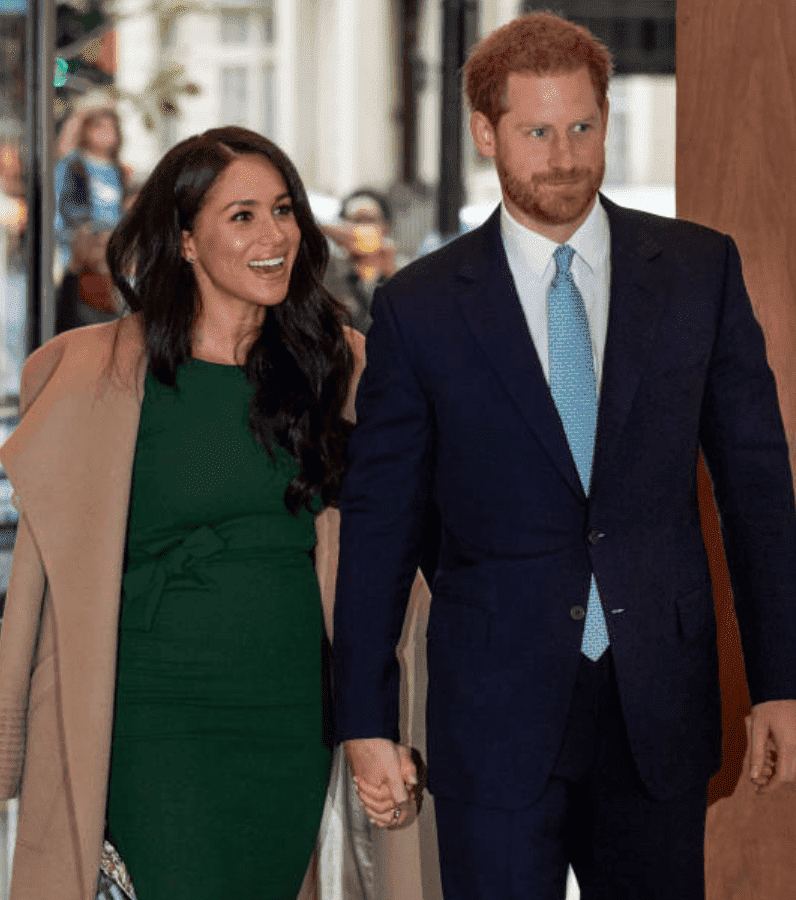 Prince Harry and Meghan Markle arrive hand in hand at the WellChild awards, on October 15, 2019, in London, England | Source: Mark Cuthbert/UK Press via Getty Images