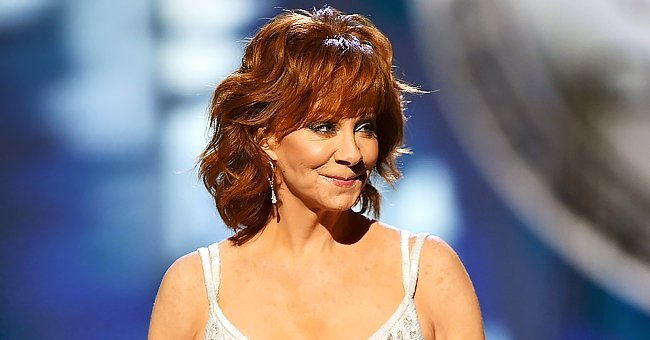 Country Music Icon Reba McEntire, 65, Defies Her Age Wearing a Gorgeous Velvet Navy Blue Blouse