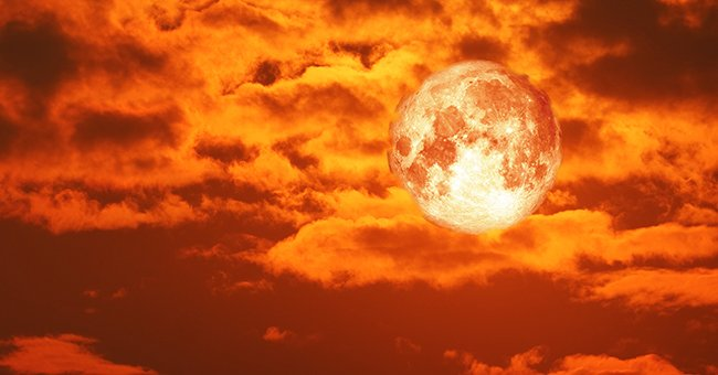 A picture of a blood moon among clouds.   Photo: Getty Images