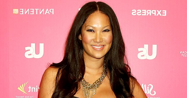 Kimora Lee Simmons' Daughter Aoki Showcases Her Slim Legs as She Poses in a Chic White Ensemble