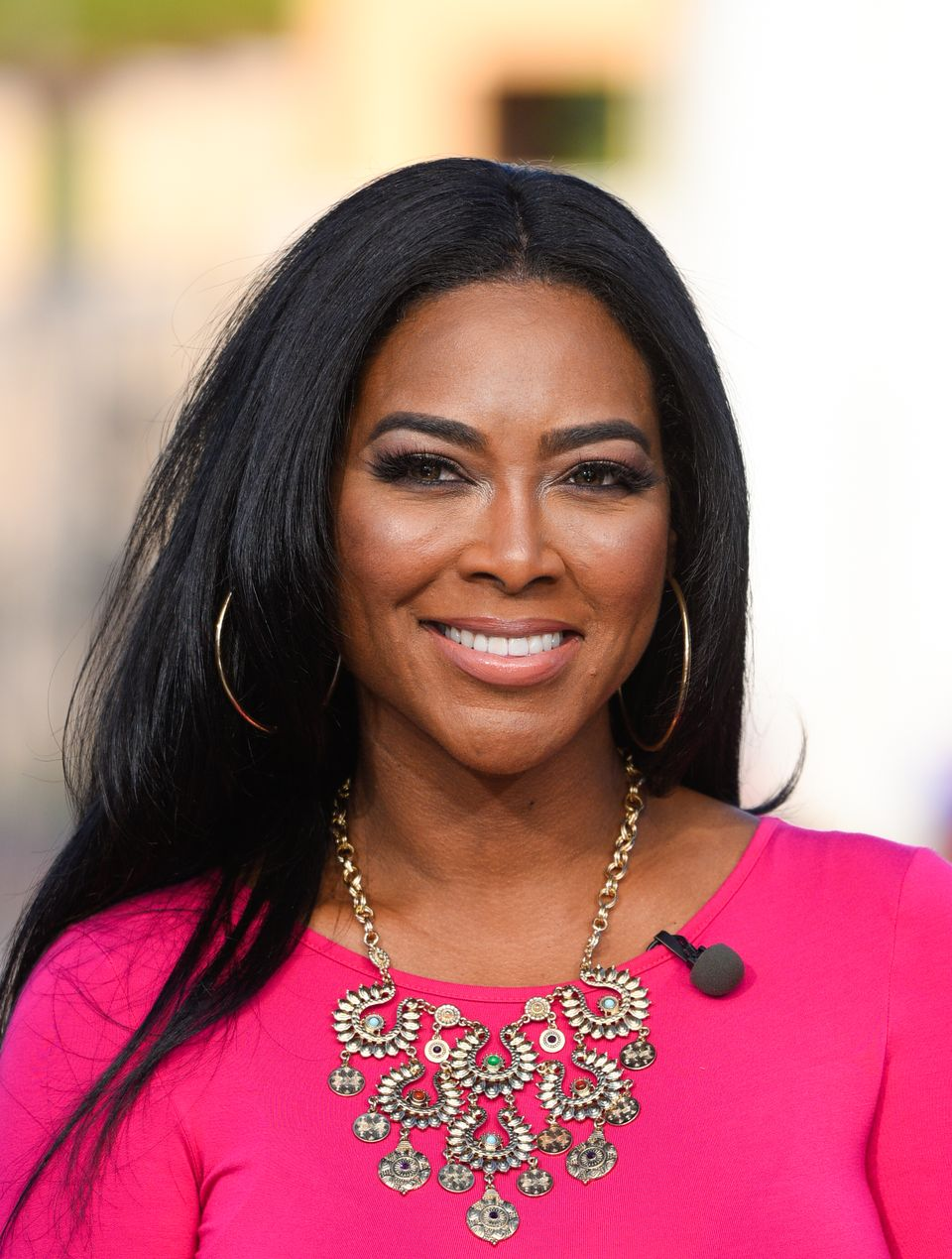 """Kenya Moore goes to """"Extra"""" at Universal Studios Hollywood on January 27, 2015 in Universal City, California. 