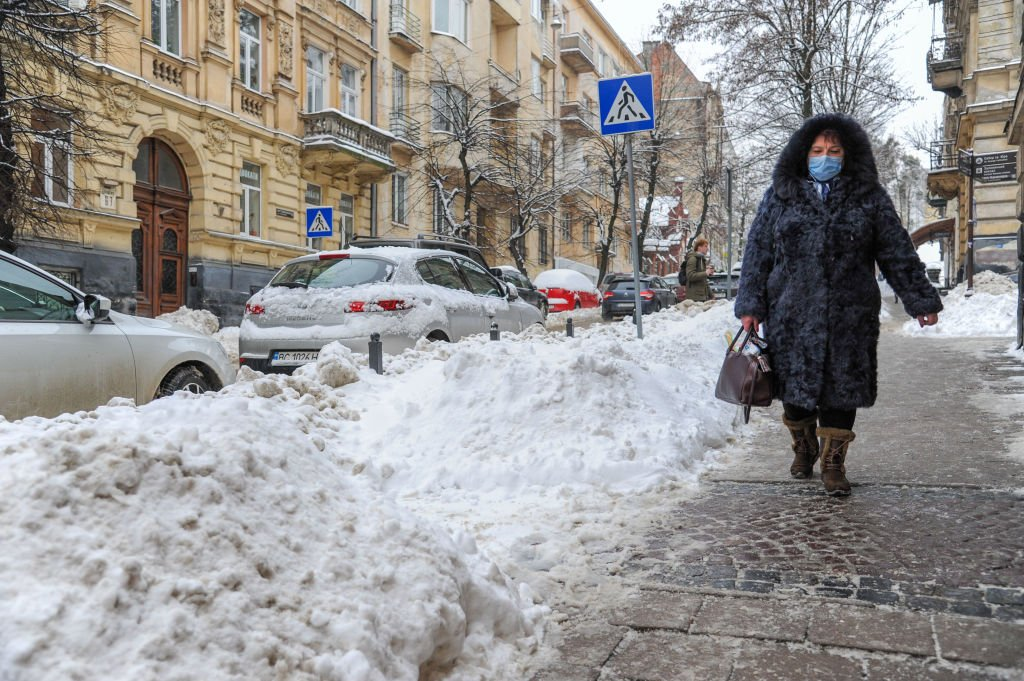 A woman walking on a snow covered street during a snowfall on February 10, 2021   Photo: Getty Images