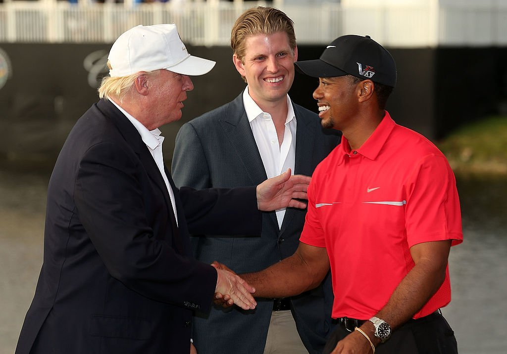 Donald Trump greets Tiger Woods after the final round of the World Golf Championships, 2013. | Photo: GettyImages
