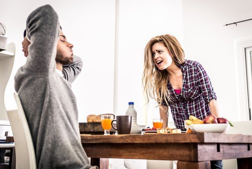 A young couple fighting at the breakfast table. | Source: Shutterstock.