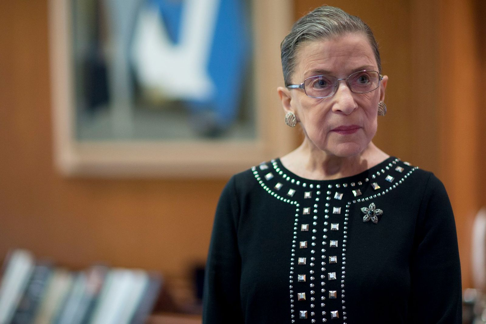 Ruth Bader Ginsburg in her chambers after an interview in Washington, D.C. on August 23, 2013 | Photo: Andrew Harrer/Bloomberg/Getty Images