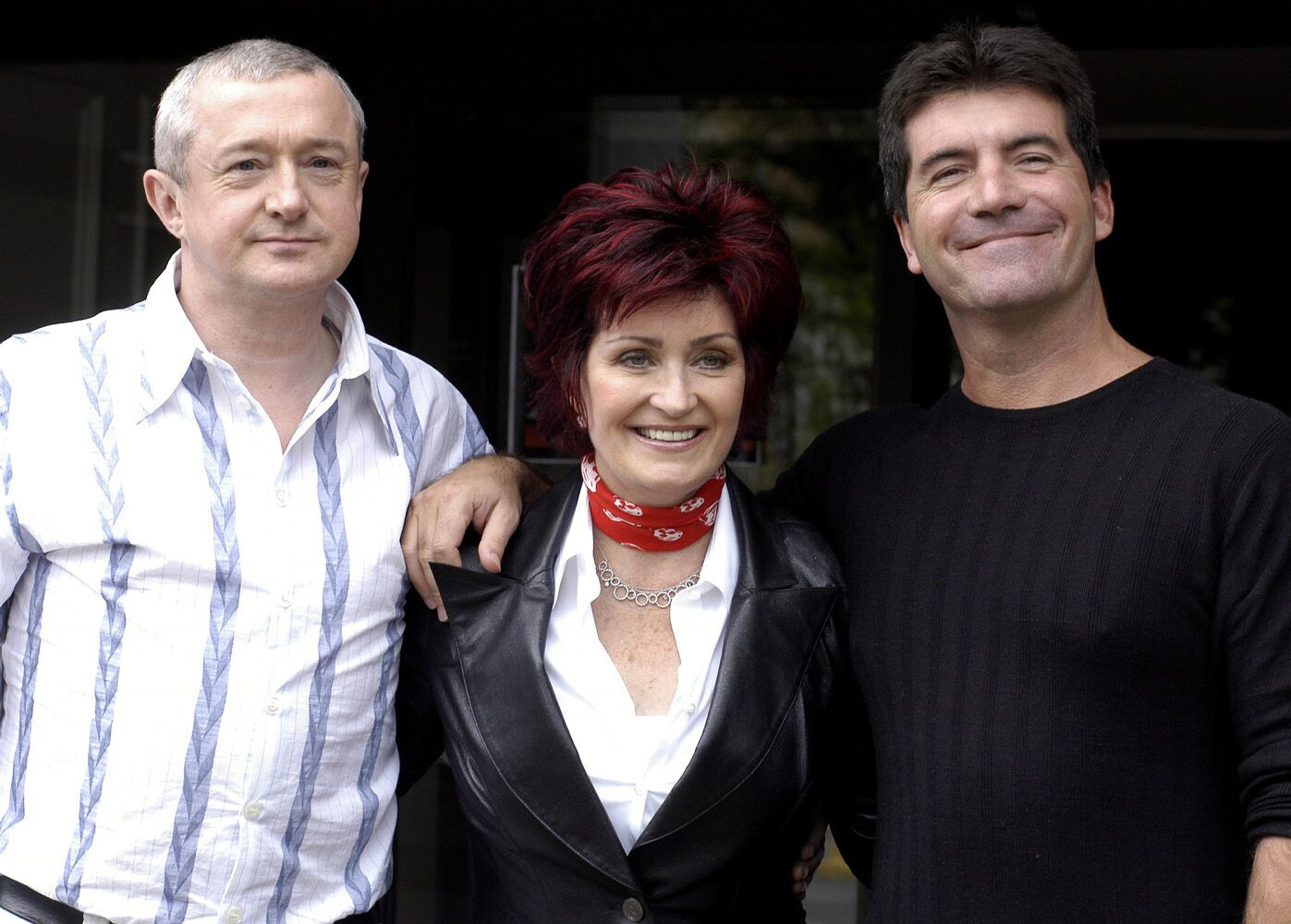 """Louis Walsh, Sharon Osbourne and Simon Cowell on set of the TV show """"X Factor"""" in 2004 