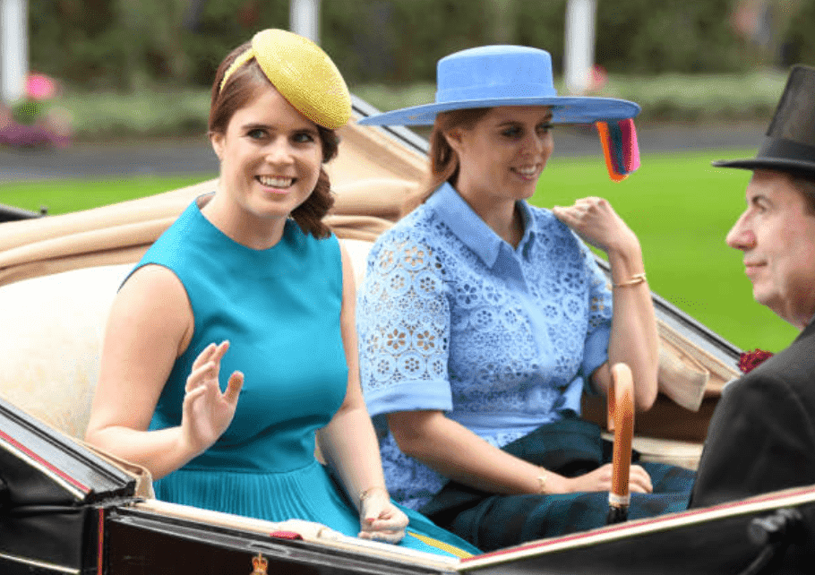 Princess Eugenie and her sister Princess Beatrice wave to crowds while sitting in a carriage at the Royal Ascot at Ascot Racecourse, on June 18, 2019, in Ascot, England |Source: Getty Images (Photo by Karwai Tang/WireImage)