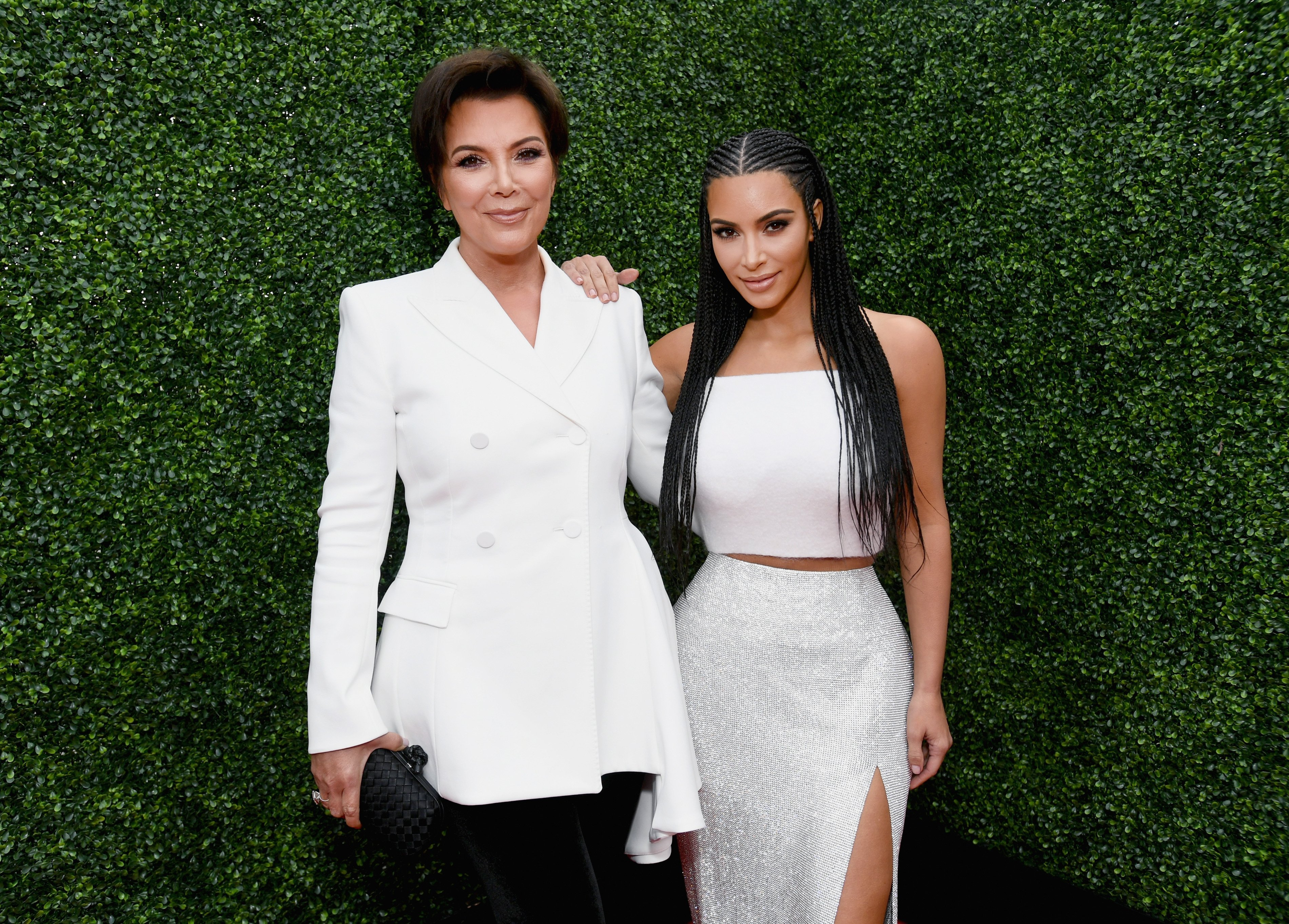Kris Jenner (L) and Kim Kardashian attend the 2018 MTV Movie And TV Awards at Barker Hangar on June 16, 2018, in Santa Monica, California. | Source: Getty Images.