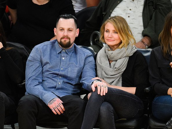 Benji Madden (L) and Cameron Diaz attend a basketball game between the Washington Wizards and the Los Angeles Lakers at Staples Center on January 27, 2015 in Los Angeles, California | Photo: Getty Images