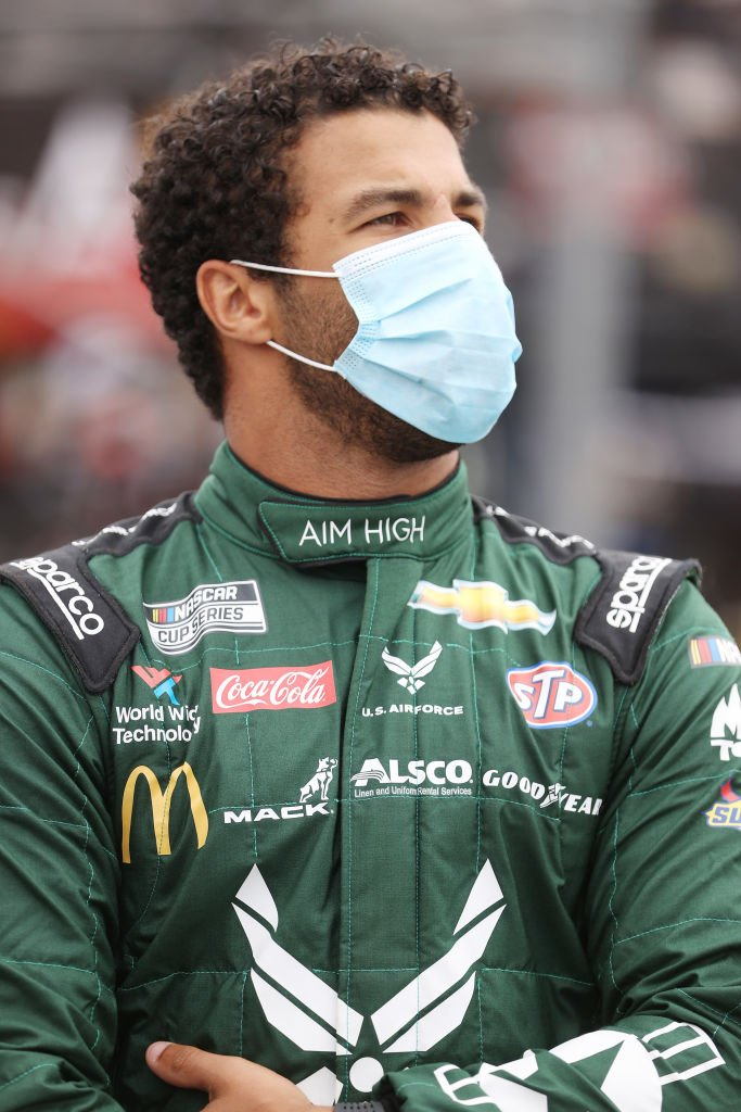 Bubba Wallace, stands on the grid prior to the NASCAR Cup Series Coca-Cola 600 at Charlotte Motor Speedway on May 24, 2020 in Concord, North Carolina | Photo: Getty Images