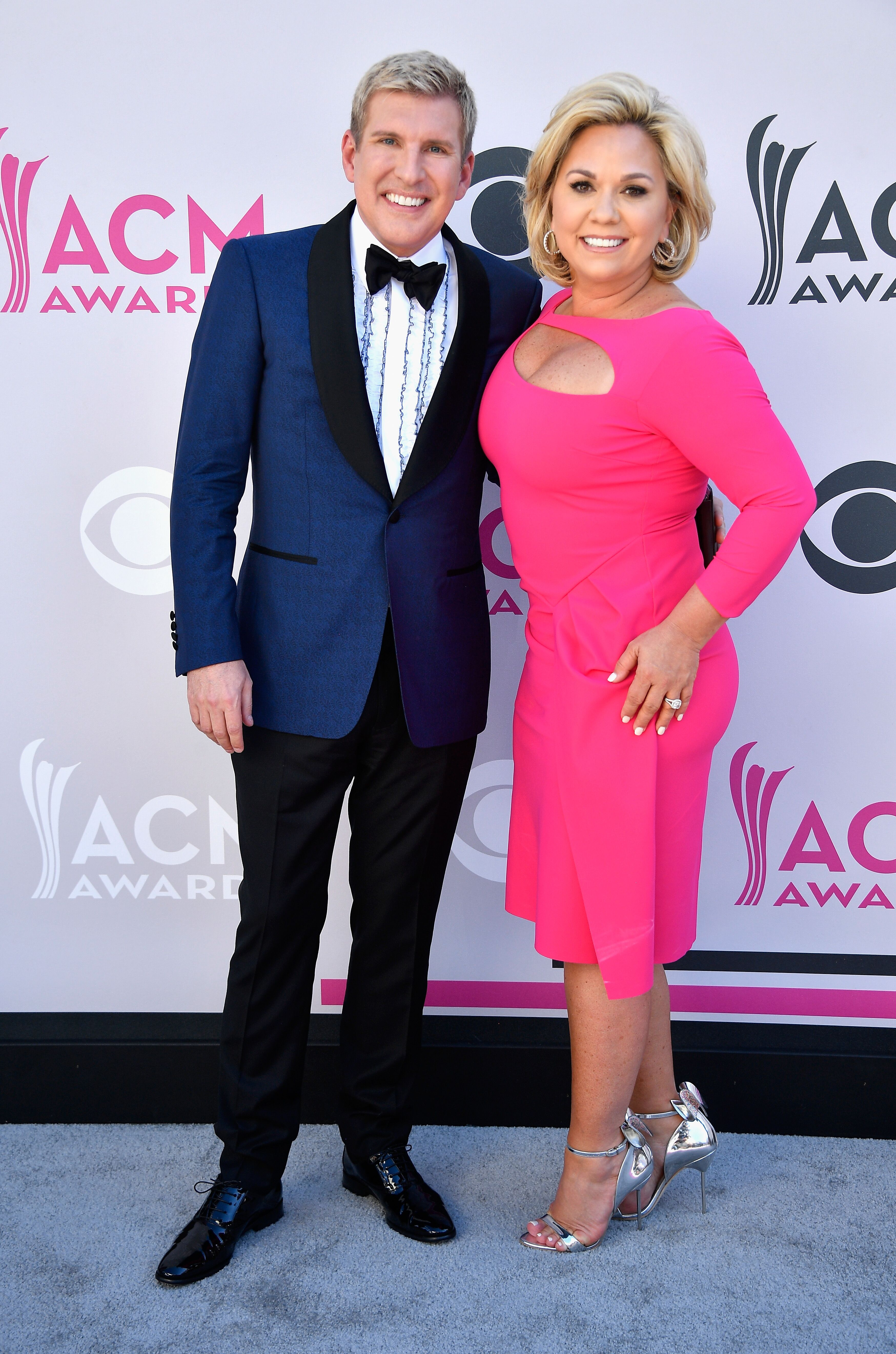 TV stars Todd and Julie Chrisley attend the 52nd Academy Of Country Music Awards at Toshiba Plaza on April 2, 2017 in Las Vegas, Nevada. | Source: Getty Images