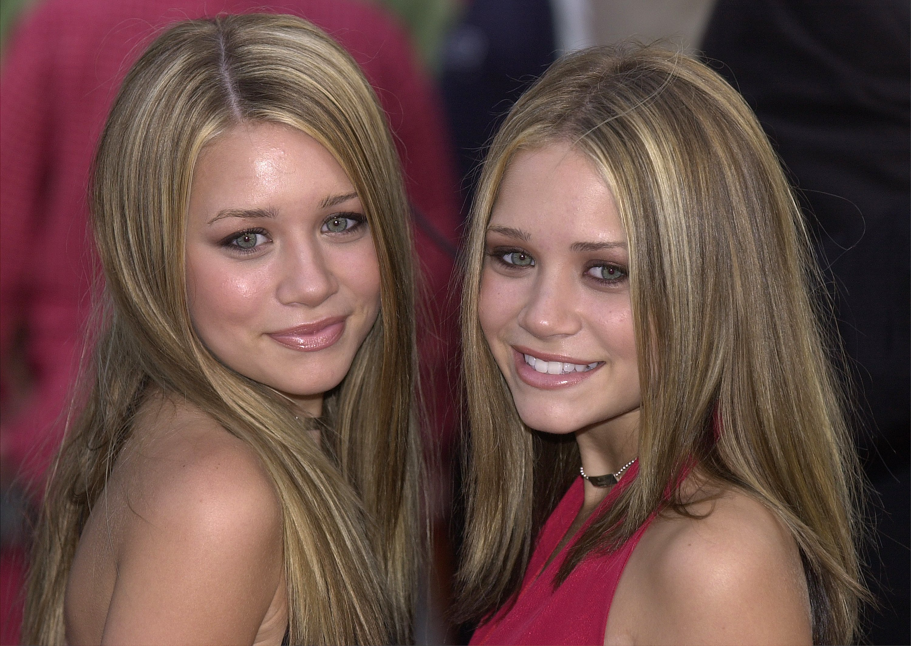 """Ashley (left) and Mary Kate Olson attend the premiere of the New Line Cinema film """"Rush Hour 2"""" July 26, 2001, in Hollywood, CA. 