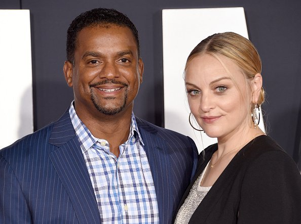 "Alfonso Ribeiro and Angela Unkrich at Paramount Pictures' Premiere Of ""Gemini Man"" in Hollywood, California.