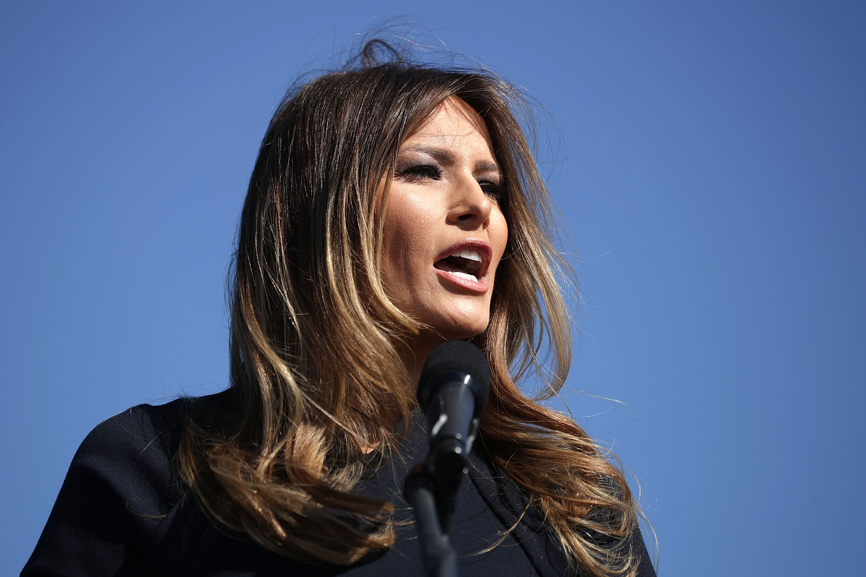 Melania Trump, wife of Republican presidential nominee Donald Trump, introduces her husband during a campaign rally the Air Wilmington Hangar located at Wilmington International Airport, North Carolina | Photo: Getty Images