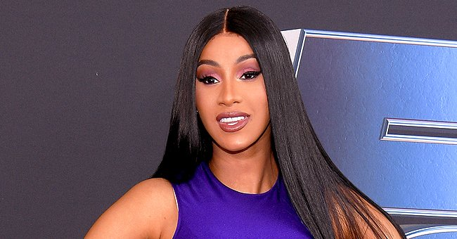 Check Out Cardi B's Poolside Look Featuring a Leopard-Print Swimsuit and Matching Heels