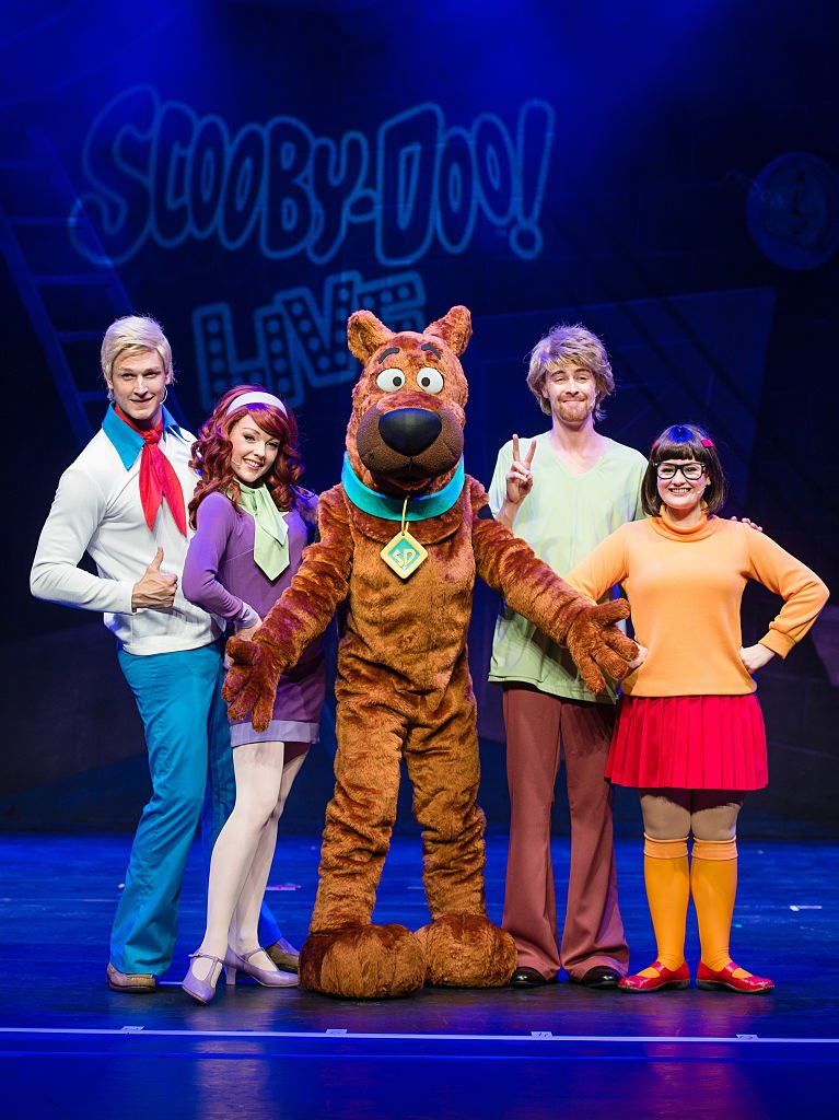 """The iconic mystery-solving gang of Scooby-doo in a 2016 broadway show called """"Scooby-Doo Live!"""" at the London Palladium in London. 