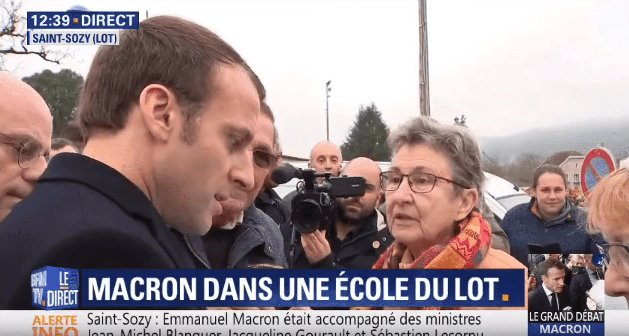 Source: Macron interpelle par une retraitée lors de sa visite dans une école du lot | Youtube / BFMTV