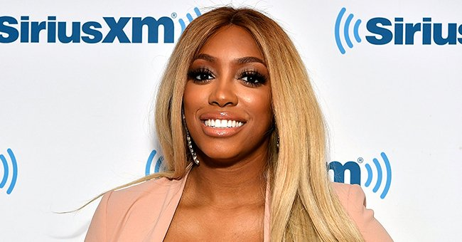 Porsha Williams Stuns in Tight Beige Jumpsuit with Deep Neckline in a Photo