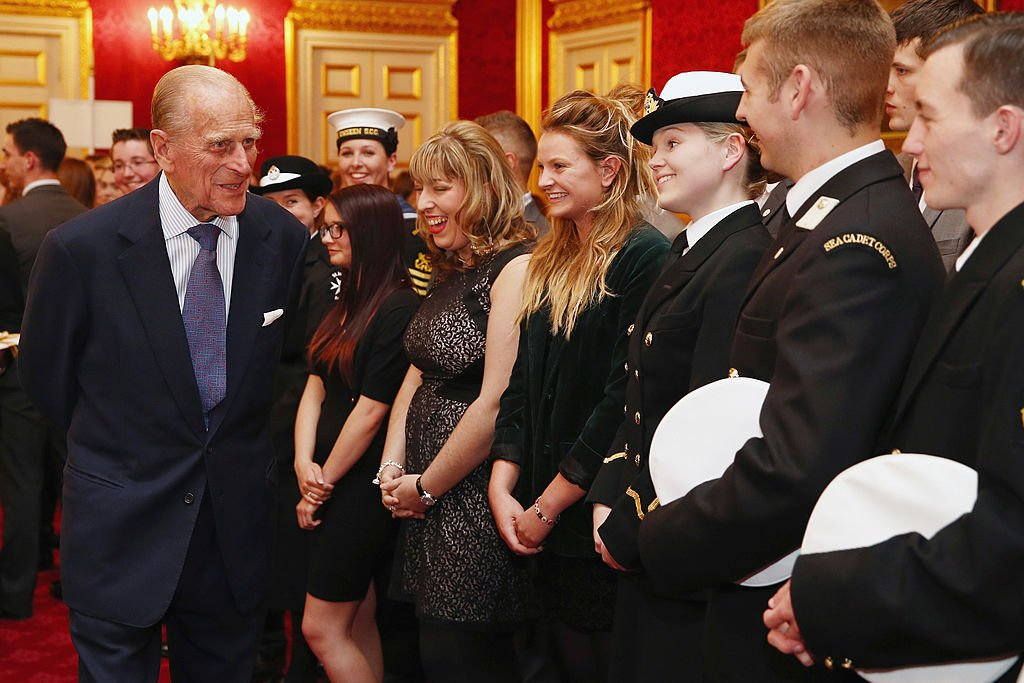 Duke of Edinburgh speaks with a group of young people during a reception at St. Jamess Palace on October 10, 2013   Photo: Getty Images