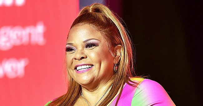 Check Out Tamela Mann's Daughter Tia Flaunting Her Curves in Skintight Burgundy Dress in New Pics