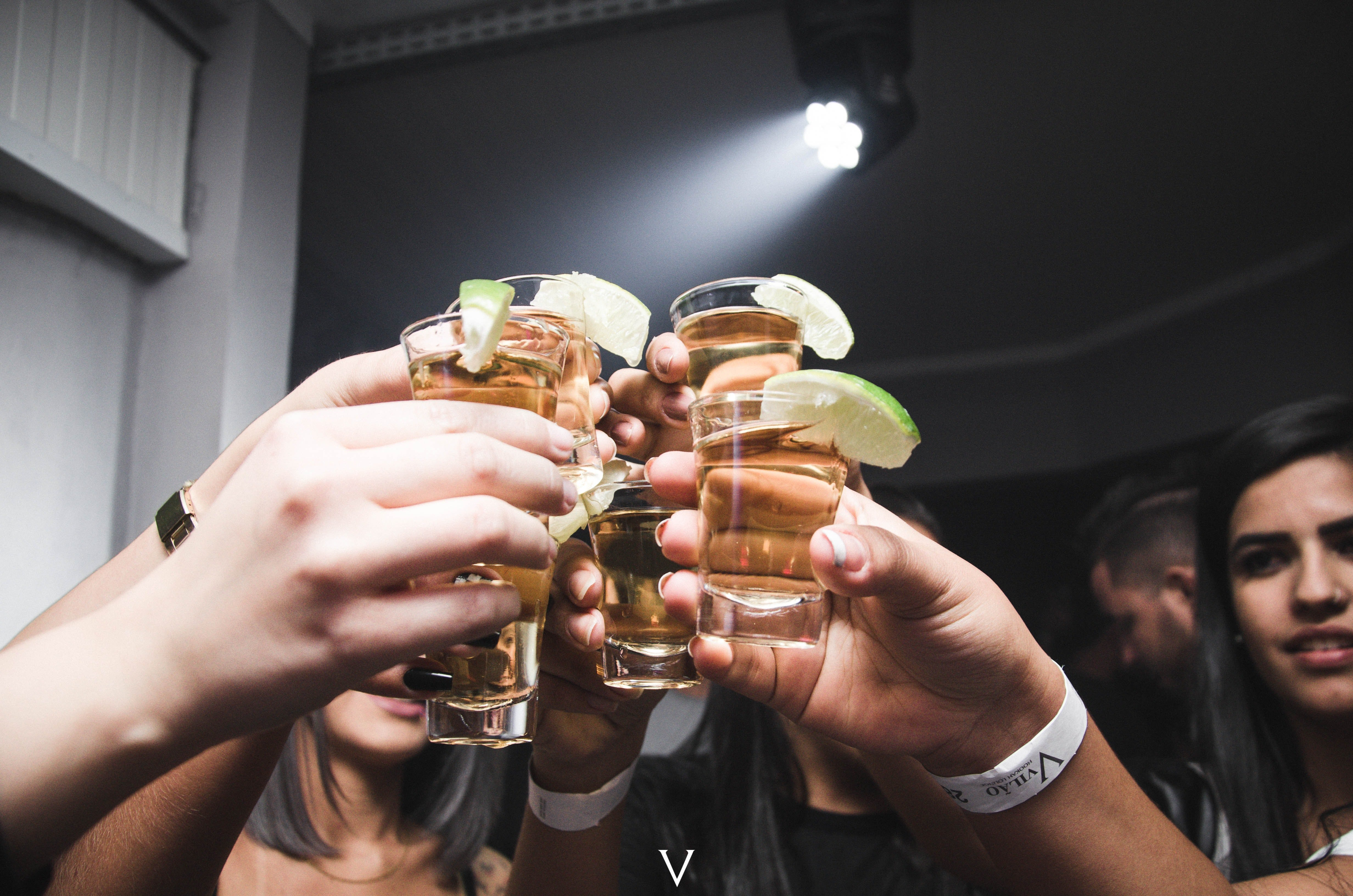 Tequila shots raised up. | Source: Pexel/ Isabella Mendes