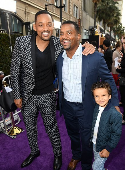 "Will Smith, Alfonso Ribeiro, and Alfonso Lincoln Ribeiro Jr. attend the premiere of Disney's ""Aladdin"" 