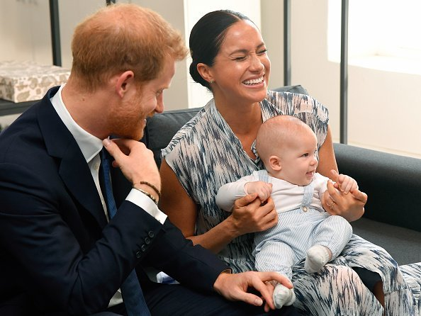 Prince Harry, Duke of Sussex, Meghan, Duchess of Sussex and their baby son Archie Mountbatten-Windsor on tour in South Africa | Getty Images