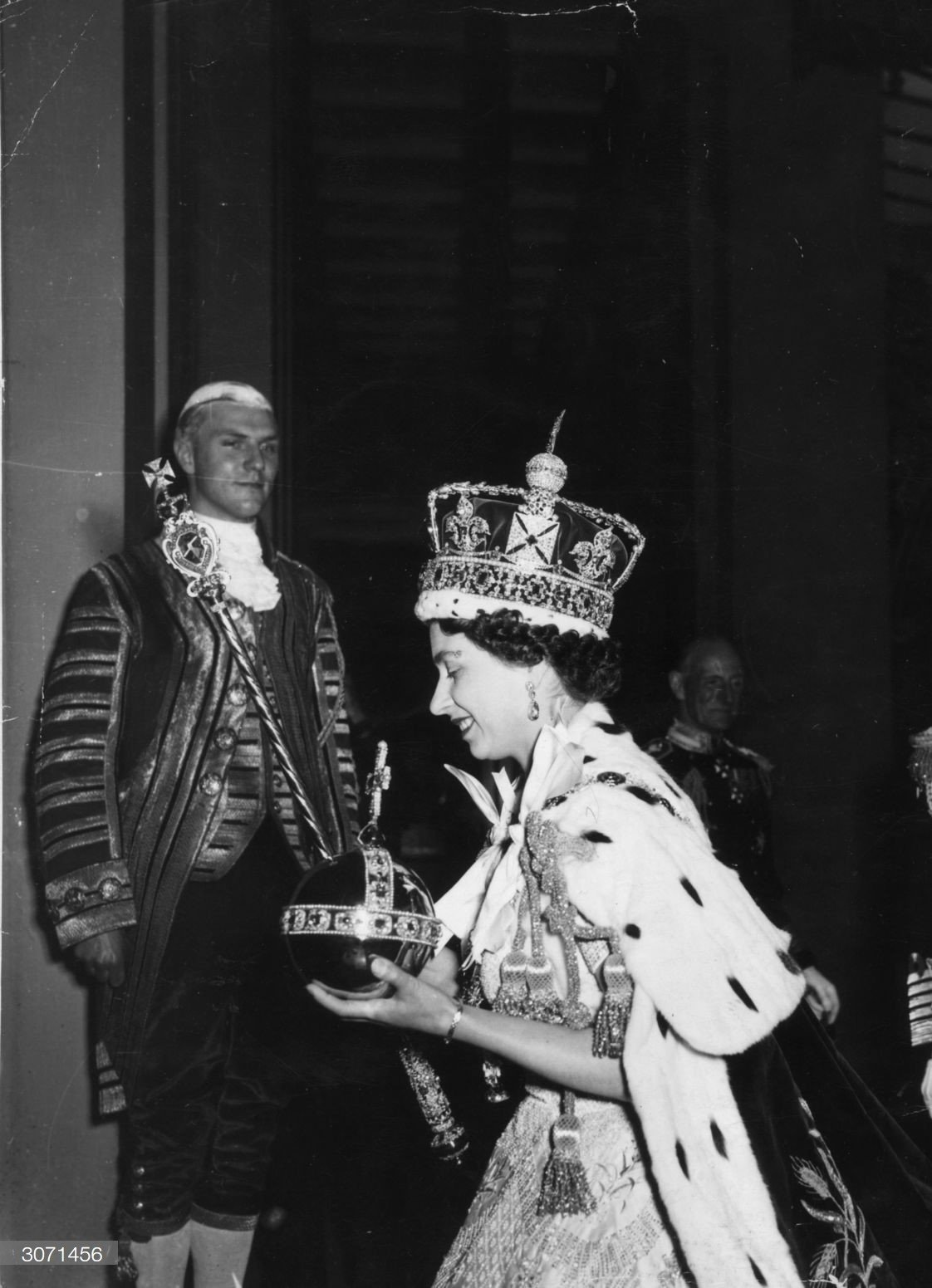 Queen Elizabeth II, wearing the Imperial State crown and carrying the Orb and Sceptre, returns to Buckingham Palace following her Coronation on 2nd June 1953.   Source: Getty Images