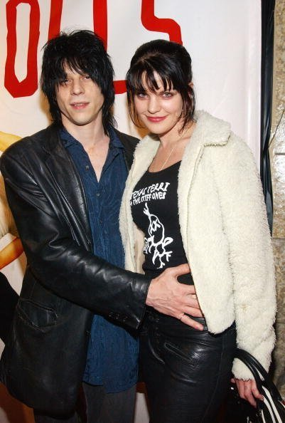 "Musician/actor Coyote Shivers (L) and wife Pauley Perrette attend the premeire of the film ""Down and Out With the Dolls"" on March 11, 2003, at CineSpace in Hollywood, California. 